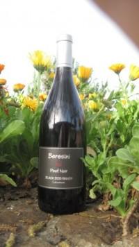 bottle of 2011 Beresini Pinot in field of flowers